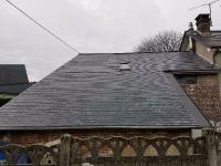 Couverture en sur toiture en ardoises naturelles dans la commune de TURRETOT