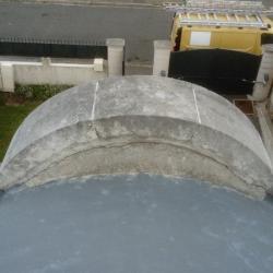 têtes de mur de lucarne ronde en plomb et relevés en zinc au HAVRE